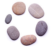 Circle of pebbles isolated on white background