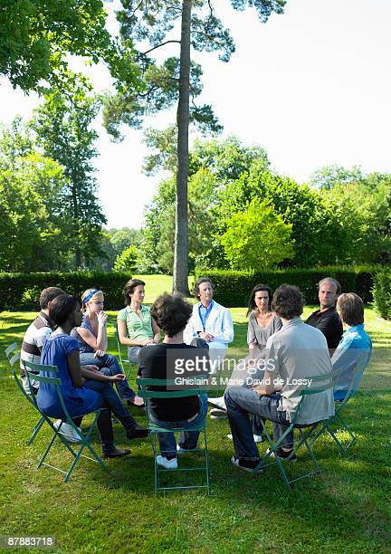Circle of people in rehab,  outdoors
