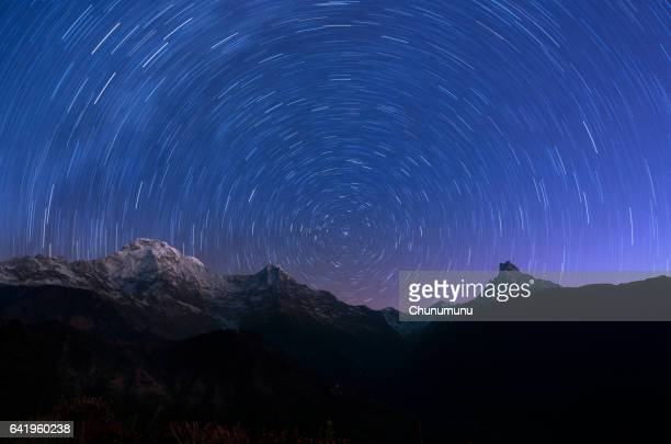 Circling stars and mountain