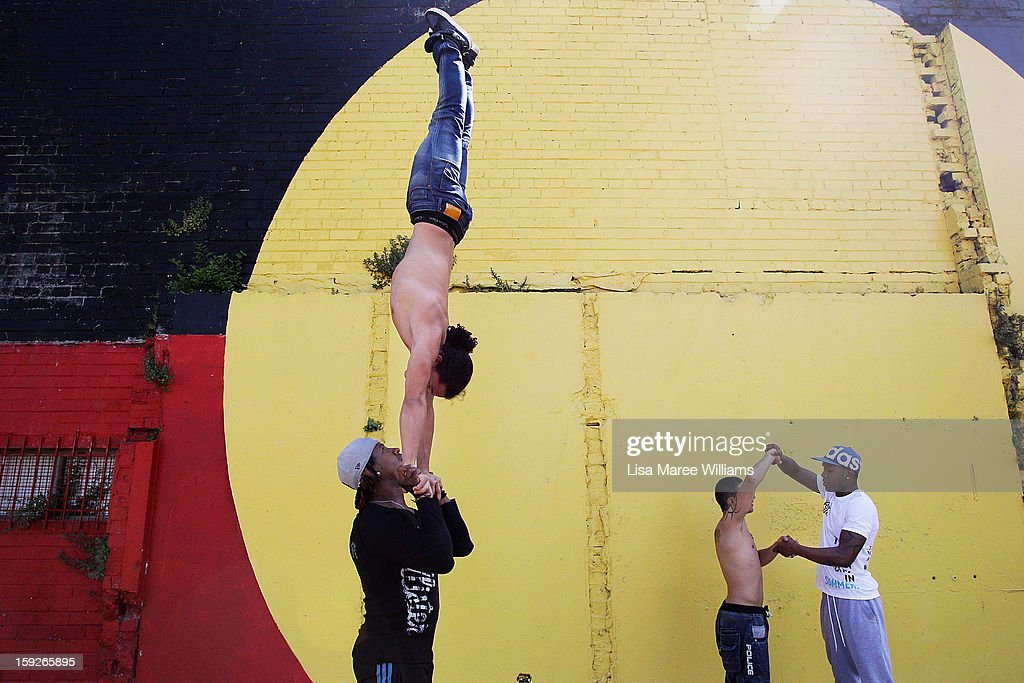 Circolombia circus performers Yeckly, Jonathon, Lil-Louce and Krespo perform some moves during a visit to the Redfern Community Centre on January 11, 2013 in Sydney, Australia. The Circolombia performers make up some of the most talented performers of Columbia's national circus school, the first school of its kind for disadvantaged youth. Circolumbia's show, URBAN, begins on January 15 at Riverside Theatre in Parramatta as part of the Sydney Festival .