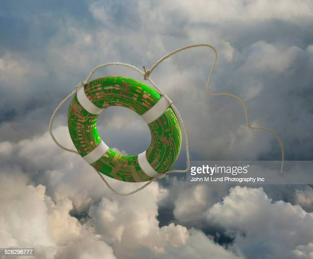 Circuit board life preserver floating in clouds