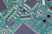 Surface-mount components on circuit board.