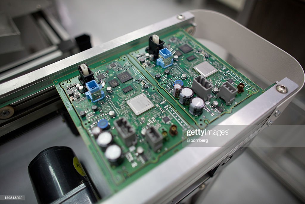 Circuit boards for the Jaguar Dual View Infotainment Control Module (ICM), produced by Robert Bosch GmbH for Jaguar Land Rover Plc, are displayed on the production line at the Robert Bosch plant in the Bayan Lepas Industrial Zone on Penang Island, Malaysia, on Thursday, Jan. 17, 2013. Robert Bosch GmbH is the world's largest automotive supplier. Photographer: Lam Yik Fei/Bloomberg via Getty Images