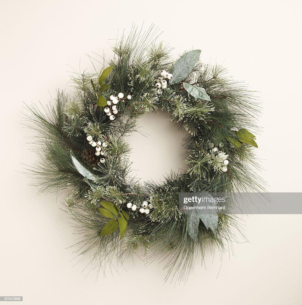 circular christmas wreath on plain background