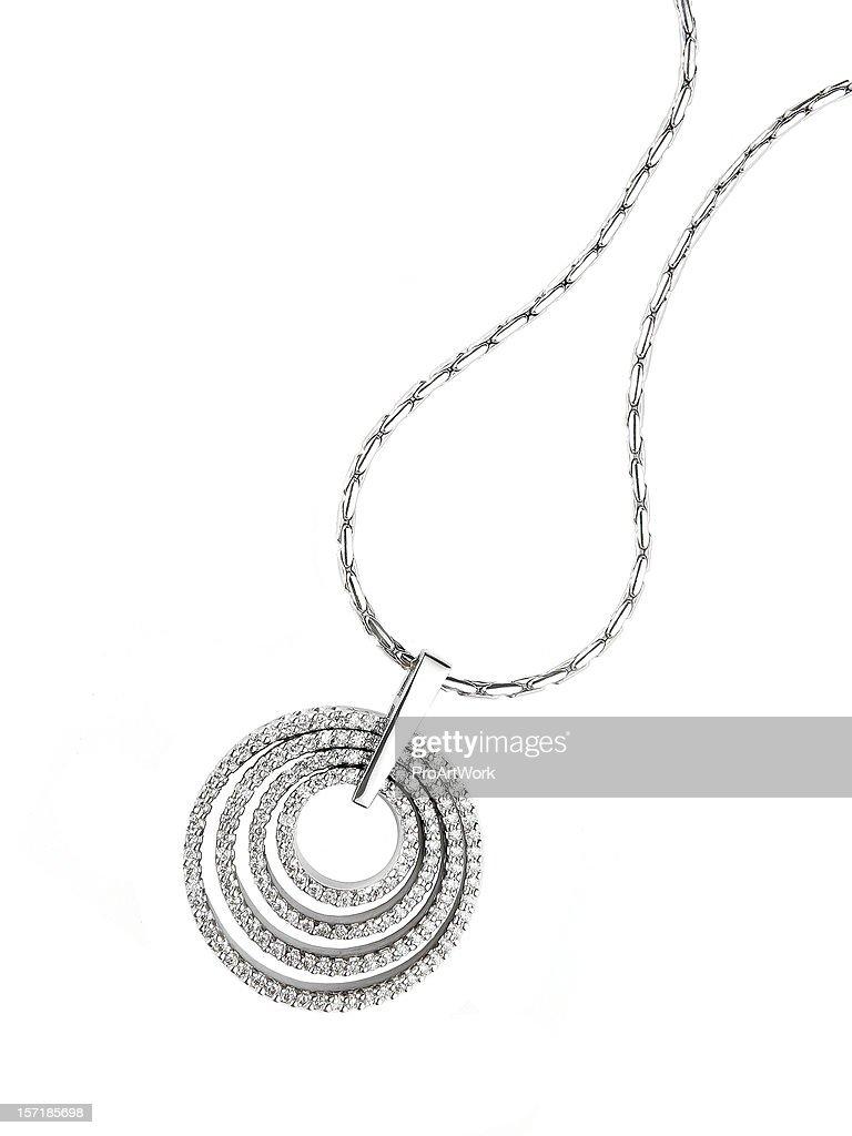 Circular diamond pendant necklace isolated on white