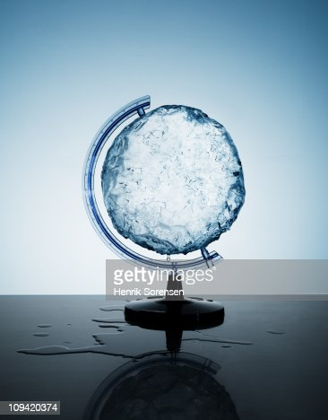 Circular ice block in a globe support holder : Stock Photo