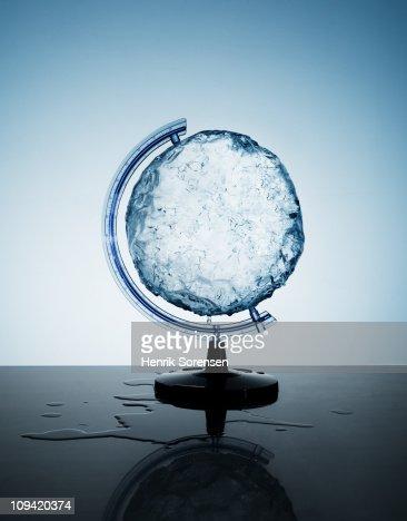 Circular ice block in a globe support holder : Photo