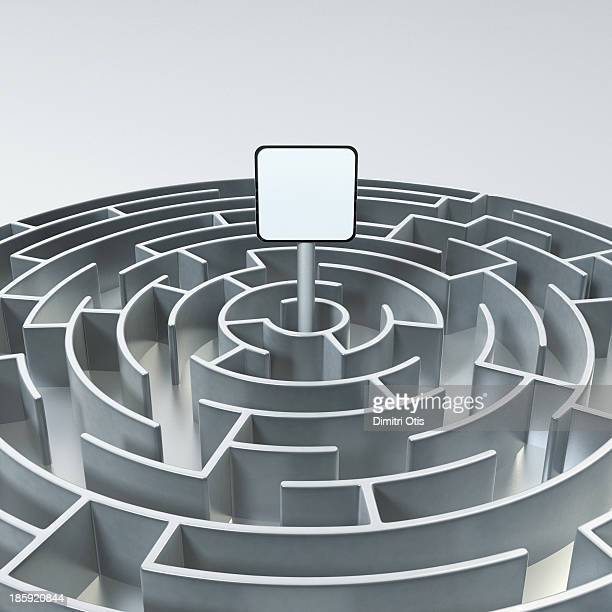 Circular metal maze with sign board