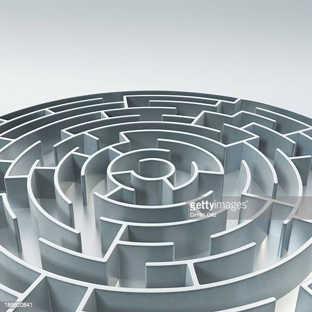 Circular metal maze with text area above