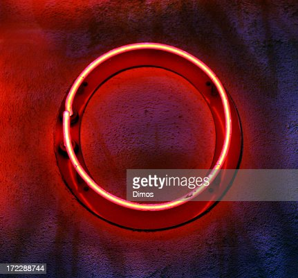 Circular neon light mounted on a wall