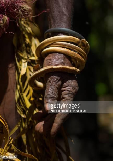 Circular pig tusks used as bracelets by a NiVanuatu man Ambrym island Fanla Vanuatu on August 29 2007 in Fanla Vanuatu