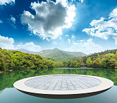 circular square floor and mountain with water nature landscape