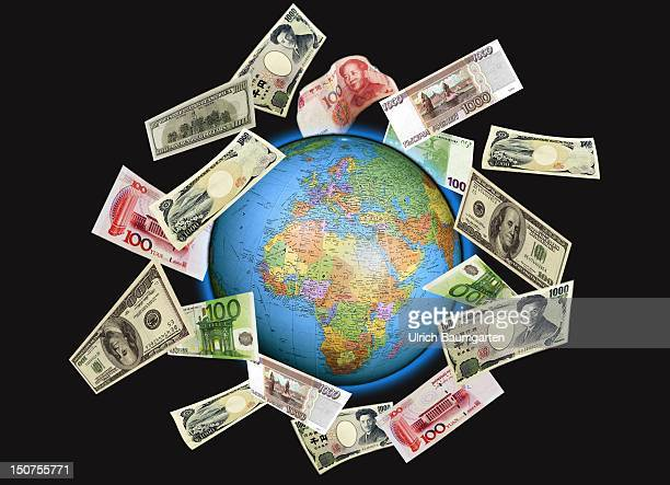 GERMANY BONN Circulation of money Euro notes dollar notes Japanese Yen notes and Chinese Yuan notes circle the globe