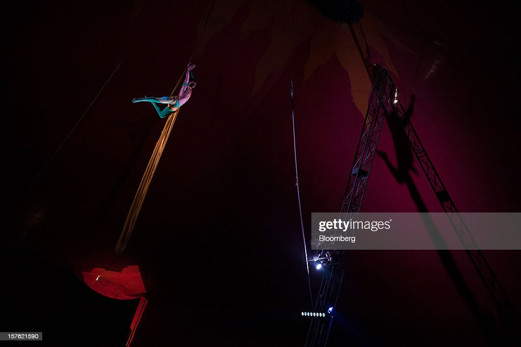 A circus acrobat performs in Bishkek, Kyrgyzstan, on Thursday, Nov. 15, 2012. Landlocked Kyrgyzstan is the only country in the world that hosts both Russian and U.S. military bases. Photographer: Noriko Hayashi/Bloomberg via Getty Images