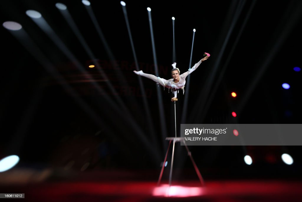 Circus artist Belova performs during the second New Generation International Circus Festival in Monaco on February 3, 2013. The event runs from February 2 until February 3, 2013. AFP PHOTO / VALERY HACHE