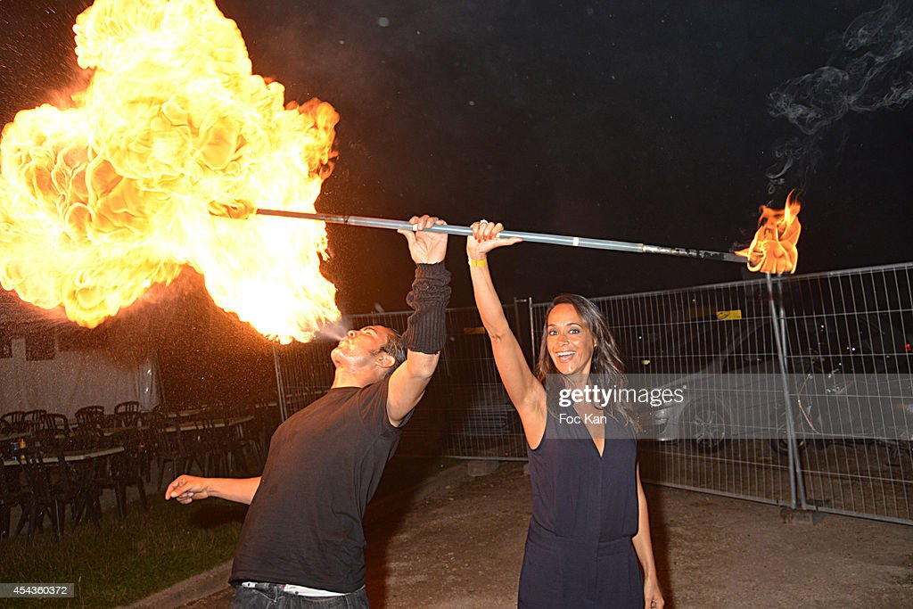 Circus artist Diego Canas and Karine Lima attend the 'Fete A Neu Neu' At Porte De La Muette on August 29 2014 in Paris France