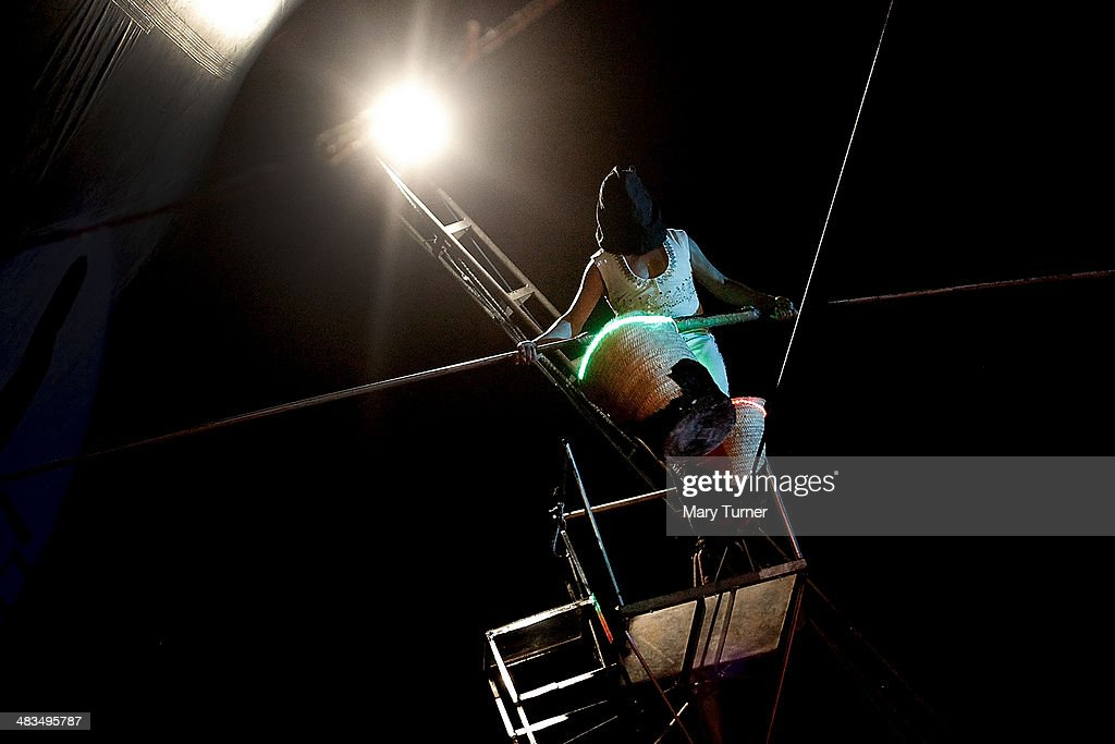 Circus artist Marco Polo begins to walk across an inch thick high-wire, blindfolded and with baskets attached to his feet and with no safety net, during Mr Fips' Wonder Circus' evening performance on April 7, 2014 in Huntingdon, England. Mr Fips Wonder Circus is a small, family run circus, who during their latest season will travel up the east of England until their season draws to a close in November. They are a company of around 20 performers, all family and friends from the circus community and their youngest member is 12 years old and their oldest is 75 years old. The troupe formed three years ago when Jan Erik Brenner and his wife Carolyn decided that they wanted to return the circus to the intimacy and magic of their childhood memories, and now play to audiences of between 100 and 500 adults and children.
