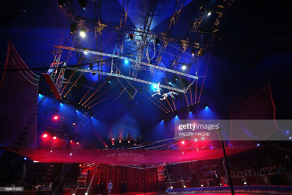 Circus artists Flying Martini perform the second New Generation International Circus Festival in Monaco on February 3, 2013. The event runs from February 2 until February 3, 2013. AFP PHOTO / VALERY HACHE