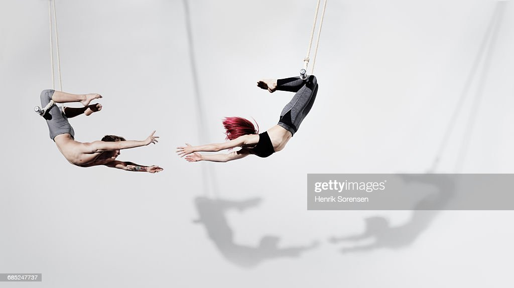 Circus artists in Trapeze : Stock Photo