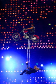 Circus artists perform using a motorcycle during the closing ceremony on day 11 of the London 2012 Paralympic Games at Olympic Stadium on September 9...