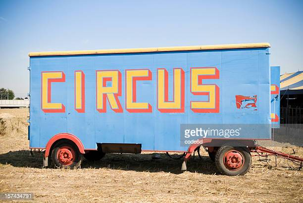 Circus car in field, copy space