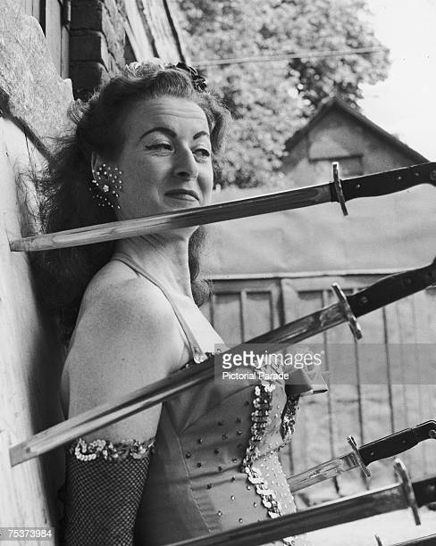 Circus knifethrowers assistant Honey Del Rio awaits her partner's next throw circa 1955