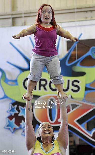 Circus Oz strongwoman Mel Fyfe holds shortstatured dancer and performer Emma J Hawkins aloft as the Australian circus renown around the world for its...