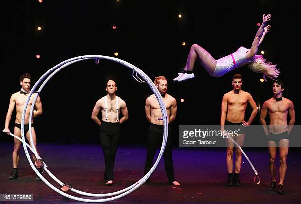 Circus performer Ashleigh Tomasini flips in the air after performing inside of a large metal wheel at the National Institute of Circus Arts 'ROUGE et...