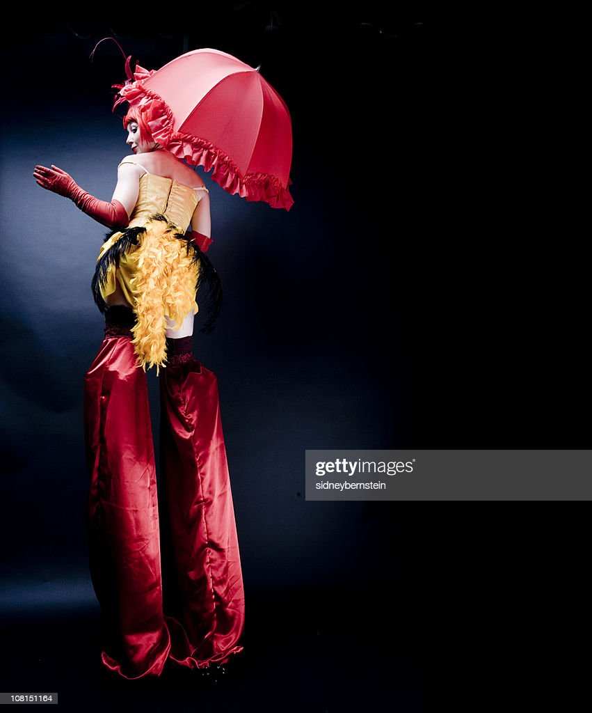 Circus Performer in Costume Wearing Stilts, Low Key