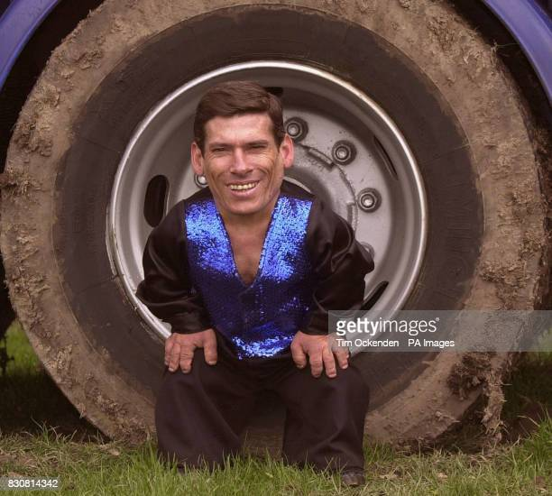 Circus performer Pitchu from Hungary seated inside the wheel of a lorry Pitchu aged 39 stands 2ft 4inches tall and claims to be the world's smallest...