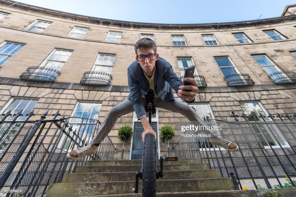 Circus performer Sam Goodburn performs on a unicycle during a photocall for his show 'Sam Goodburn: Dumbstruck' at Royal Circus during the 70th Edinburgh Fringe Festival on August 7, 2017 in Edinburgh, Scotland.