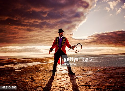 Circus Ring Master in a Dramatic Desert Setting