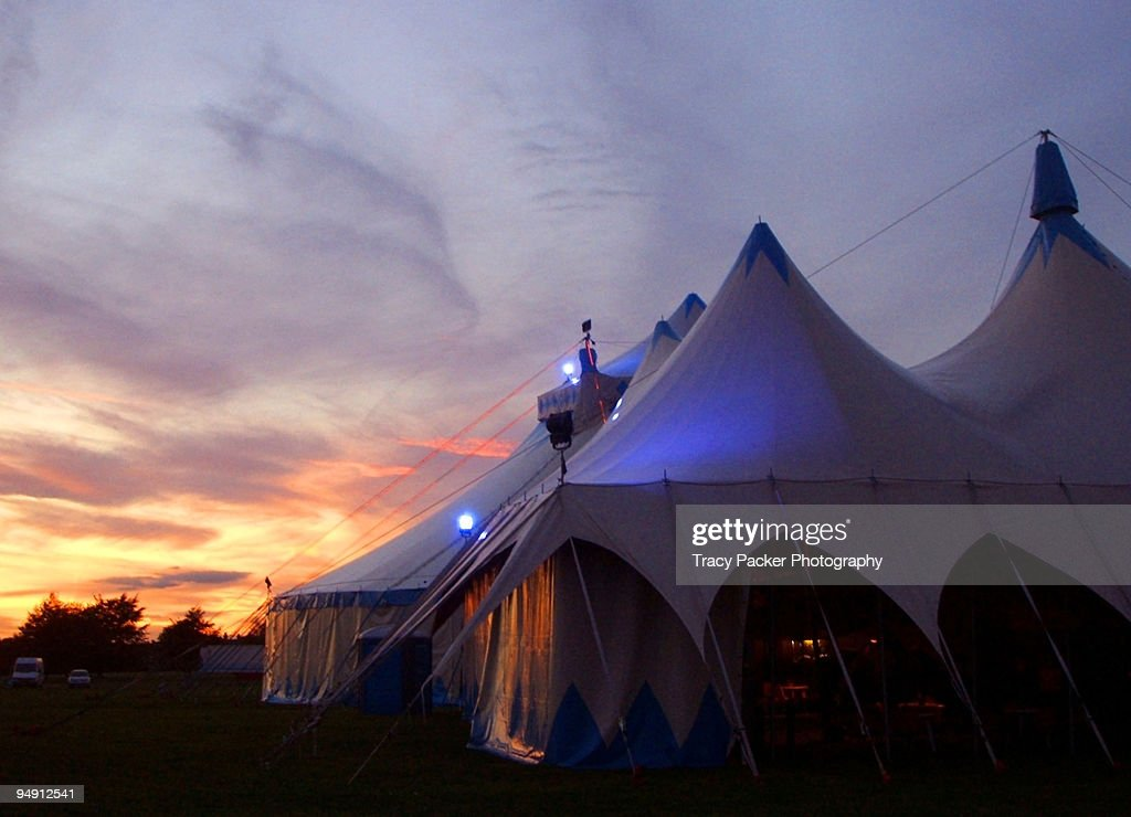 A Circus Tent Lit With Twilight and Blue Neon. : Stock Photo