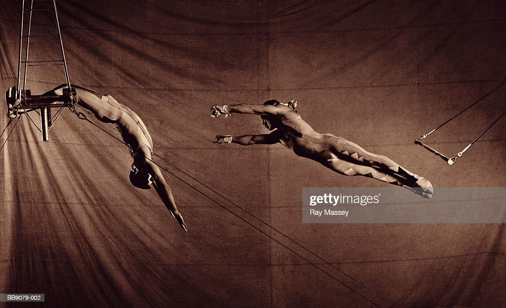 Circus trapeze artists performing (toned B&W)
