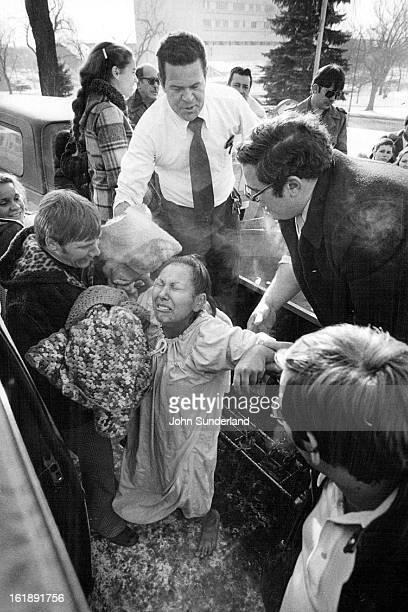 1141979 JAN 16 1979 Ciria Gonzales weeps after her total immersion Baptism Rev Maurice Gordon
