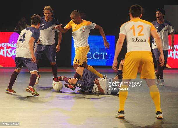 Cirilo from the Chennai 5's plays against the Kochi 5's Gekabert during their Premier Futsal Football League match in Chennai on July 15 2016 / AFP /...