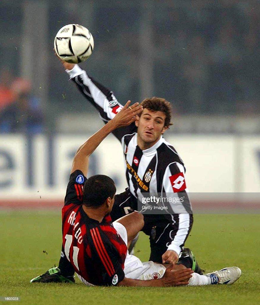 Ciro Ferrara of Juventus and Rivaldo of AC Milan in action