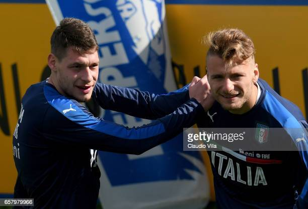 Ciro Immobile and Andrea Belotti of Italy chat during the Italy training session at the club's training ground at Coverciano on March 26 2017 in...