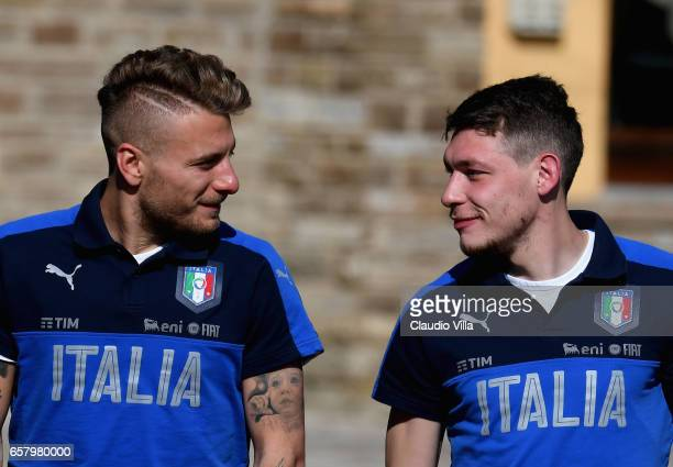 Ciro Immobile and Andrea Belotti of Italy chat prior to the Italy training session at the club's training ground at Coverciano on March 26 2017 in...