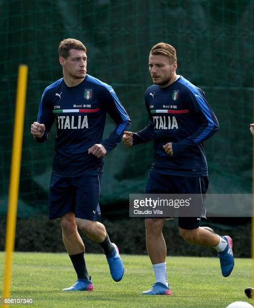 Ciro Immobile and Andrea Belotti of Italy in action during the training session at the club's training ground at Coverciano on March 21 2017 in...