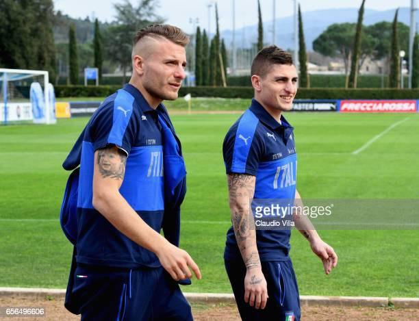 Ciro Immobile and Marco Verratti of Italy chat prior to the training session at the club's training ground at Coverciano on March 22 2017 in Florence...