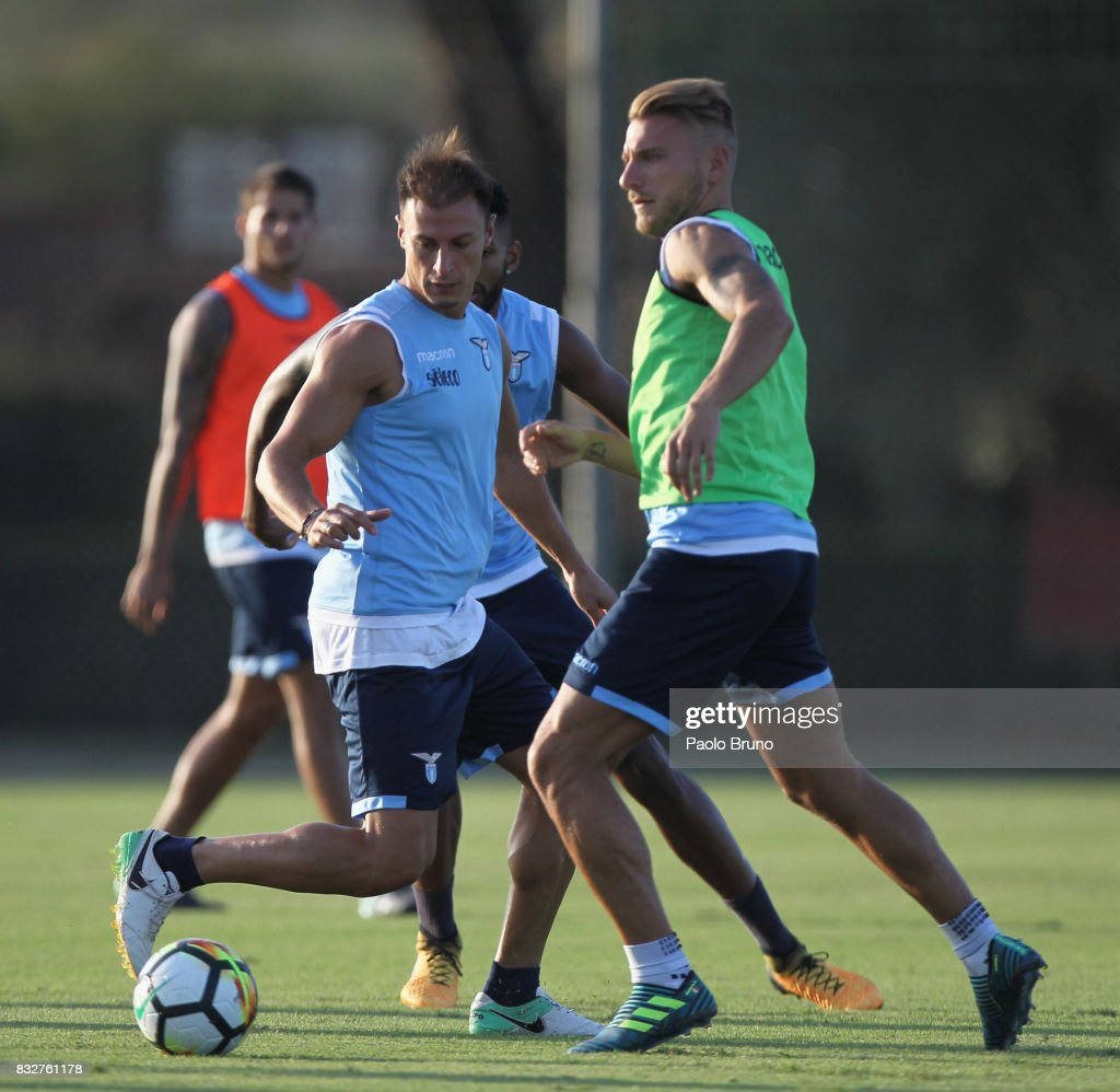 Ciro Immobile and Stefan Radu of SS Lazio in action during the SS Lazio training session on August 16, 2017 in Rome, Italy.