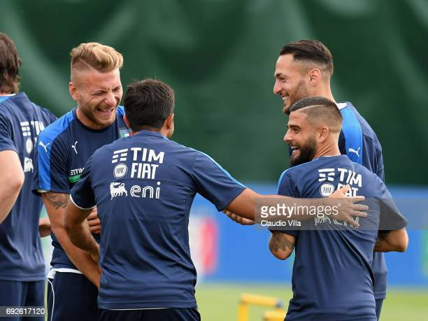 Ciro Immobile Eder Lorenzo Insigne and Danilo D'Ambrosio chat during the training session at Coverciano on June 05 2017 in Florence Italy