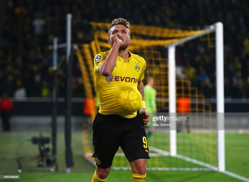 <a gi-track='captionPersonalityLinkClicked' href=/galleries/search?phrase=Ciro+Immobile&family=editorial&specificpeople=5820229 ng-click='$event.stopPropagation()'>Ciro Immobile</a> of Borussia Dortmund celebrates scoring the opening goal during the UEFA Champions League Group D match between Borussia Dortmund and RSC Anderlecht at Signal Iduna Park on December 9, 2014 in Dortmund, Germany.