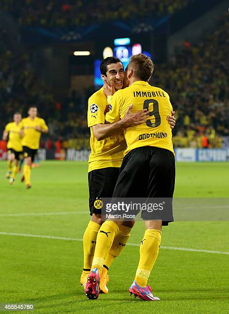 Ciro Immobile of Borussia Dortmund is congratulated by teammate Henrikh Mkhitaryan of Borussia Dortmund after scoring the opening goal on the stroke...