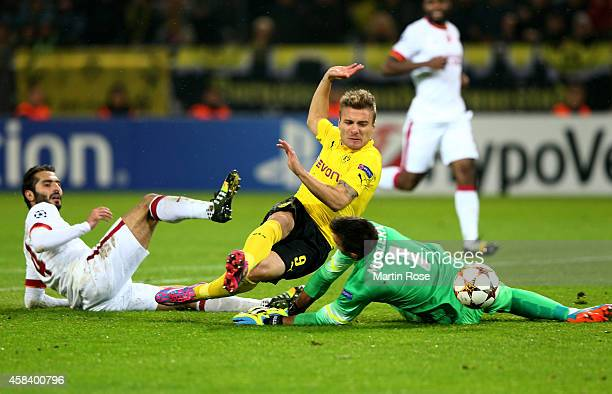 Ciro Immobile of Borussia Dortmund scores his team'sthird goal past goalkeeper Fernando Muslera of Galatasaray during the UEFA Champions League Group...