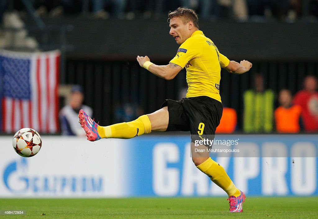 <a gi-track='captionPersonalityLinkClicked' href=/galleries/search?phrase=Ciro+Immobile&family=editorial&specificpeople=5820229 ng-click='$event.stopPropagation()'>Ciro Immobile</a> of Borussia Dortmund scores their first goal during the UEFA Champions League Group D match between RSC Anderlecht and Borussia Dortmund at Constant Vanden Stock Stadium on October 1, 2014 in Anderlecht, Belgium.