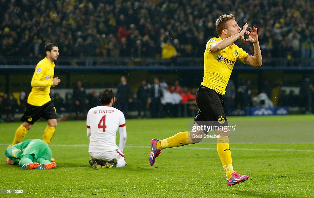 <a gi-track='captionPersonalityLinkClicked' href=/galleries/search?phrase=Ciro+Immobile&family=editorial&specificpeople=5820229 ng-click='$event.stopPropagation()'>Ciro Immobile</a> (R) of Dortmund celebrates after scoring his team's third goal during the UEFA Champions League Group D match between Borussia Dortmund and Galatasaray AS at Signal Iduna Park on November 4, 2014 in Dortmund, Germany.
