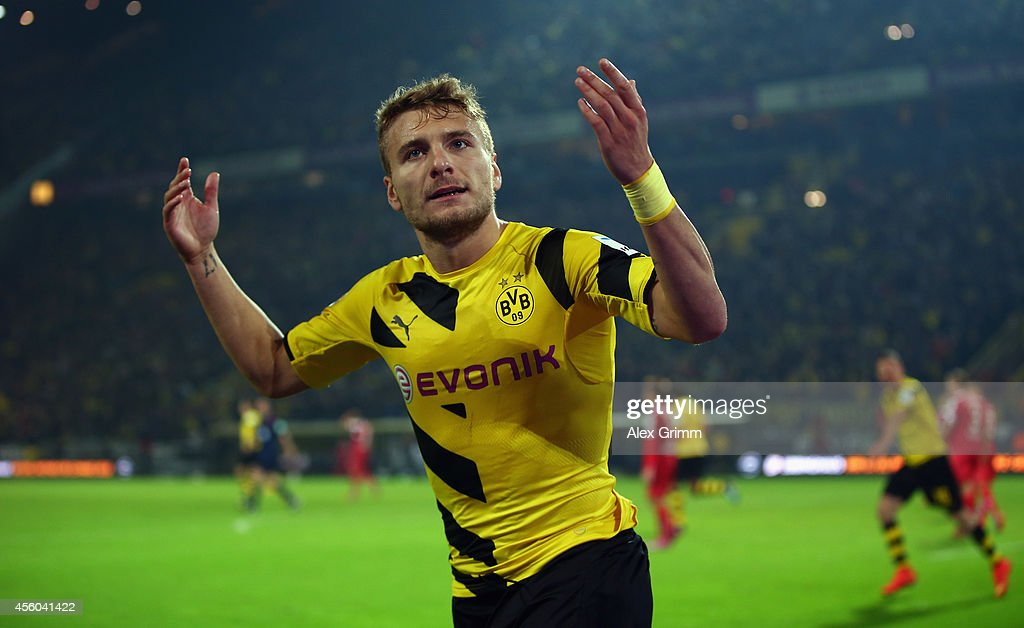 <a gi-track='captionPersonalityLinkClicked' href=/galleries/search?phrase=Ciro+Immobile&family=editorial&specificpeople=5820229 ng-click='$event.stopPropagation()'>Ciro Immobile</a> of Dortmund celebrates his team's second goal during the Bundesliga match between Borussia Dortmund and VfB Stuttgart at Signal Iduna Park on September 24, 2014 in Dortmund, Germany.