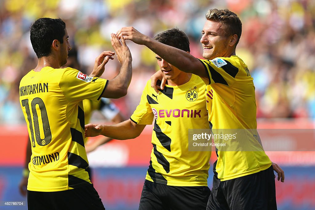 <a gi-track='captionPersonalityLinkClicked' href=/galleries/search?phrase=Ciro+Immobile&family=editorial&specificpeople=5820229 ng-click='$event.stopPropagation()'>Ciro Immobile</a> of Dortmund (R) celebrates the fifth goal with <a gi-track='captionPersonalityLinkClicked' href=/galleries/search?phrase=Henrikh+Mkhitaryan&family=editorial&specificpeople=6234732 ng-click='$event.stopPropagation()'>Henrikh Mkhitaryan</a> (L) and <a gi-track='captionPersonalityLinkClicked' href=/galleries/search?phrase=Jonas+Hofmann&family=editorial&specificpeople=9171269 ng-click='$event.stopPropagation()'>Jonas Hofmann</a> (C) of Dortmund during the friendly match between Rot Weiss Essen and Borussia Dortmund at Stadion Essen on July 27, 2014 in Essen, Germany.